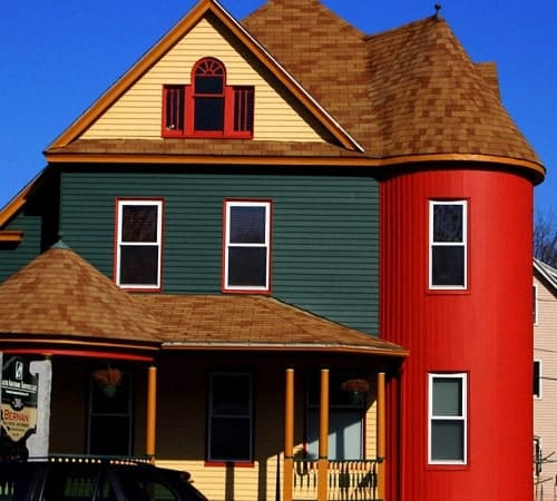 Two story home with siding replacement by San Marcos professionals