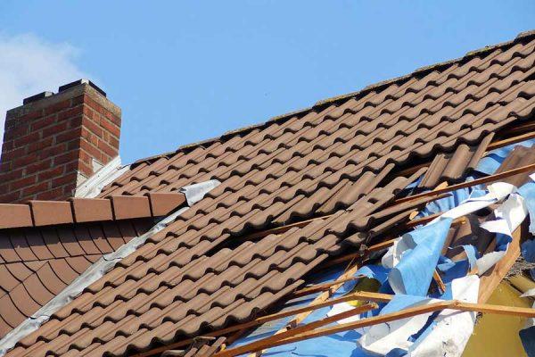 A tile roof sustains major storm damage.