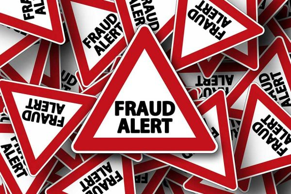 Triangular road signs with the warning Fraud Alert
