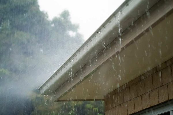 A home's gutter diverts rain water away from the roof.