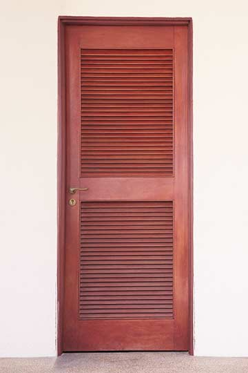 A red louvered door