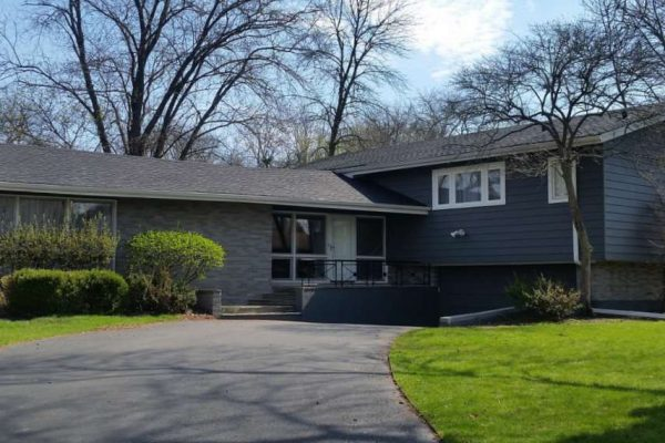 home with asphalt shingle roof installed by Buda roofers