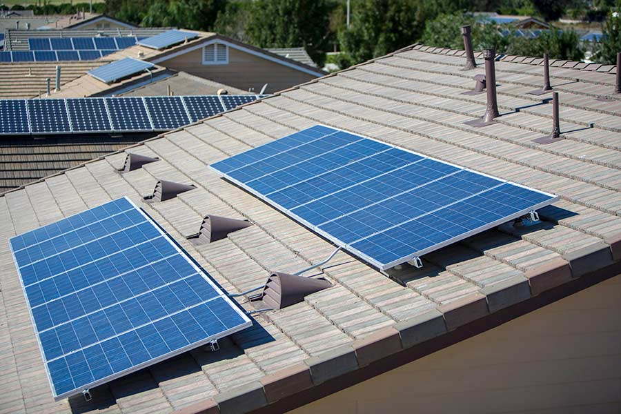 Solar panels on roof installed by a San Marcos TX roofing company