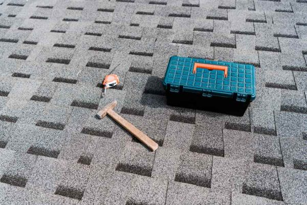 shingle roof with tools for roof repair in Buda TX