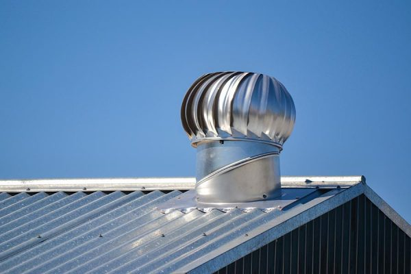 Attic ventilation system on a metal roof installed by our Buda roofers