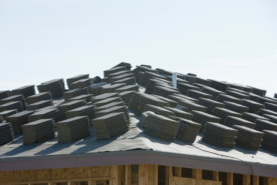 Shingles stacked on a roof by a San Marcos roofing team