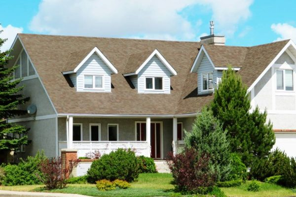 Exterior of two story home with shingle roof