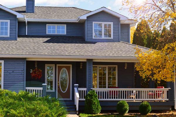 Suburban home with a roof installed by a Kyle TX roofing company
