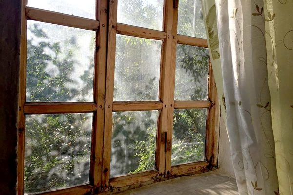 An old window in need of New Window Replacement in Kyle TX