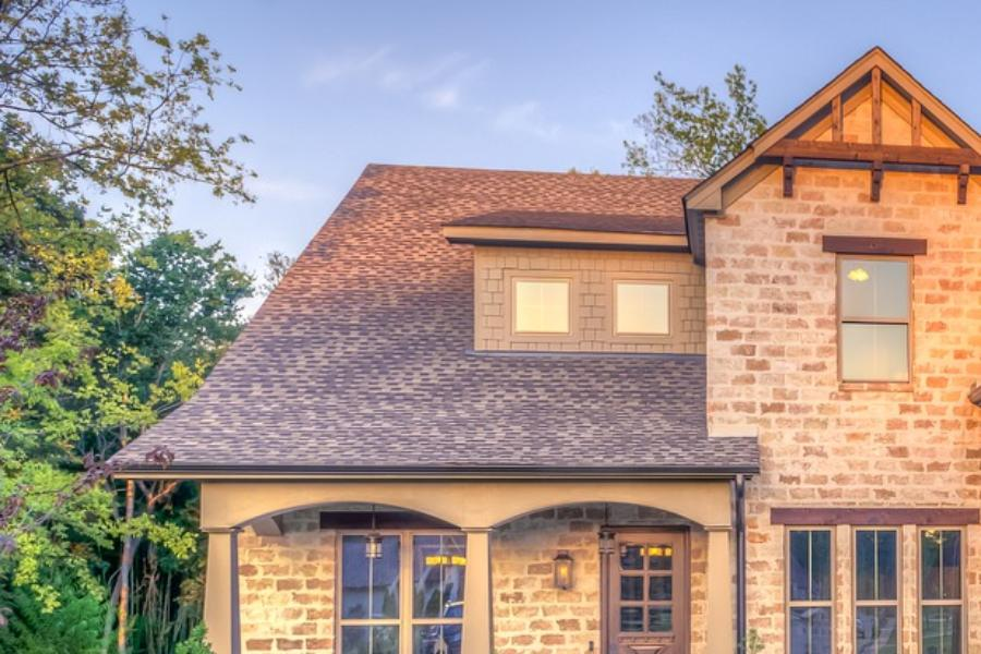 Brown home with shingle roof