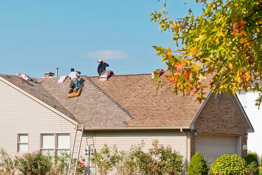 San Marcos TX roofing team performing roof maintenance in fall