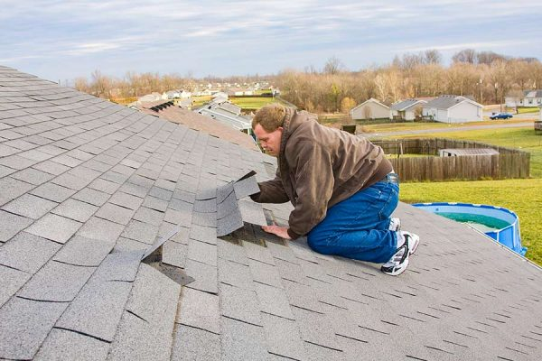 Homeowner Attempting to repair a roof without the help of a Kyle TX roofing company