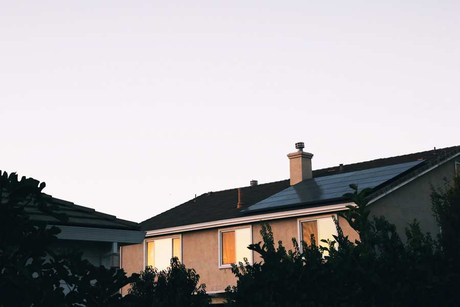 Suburban home with solar panels on roof