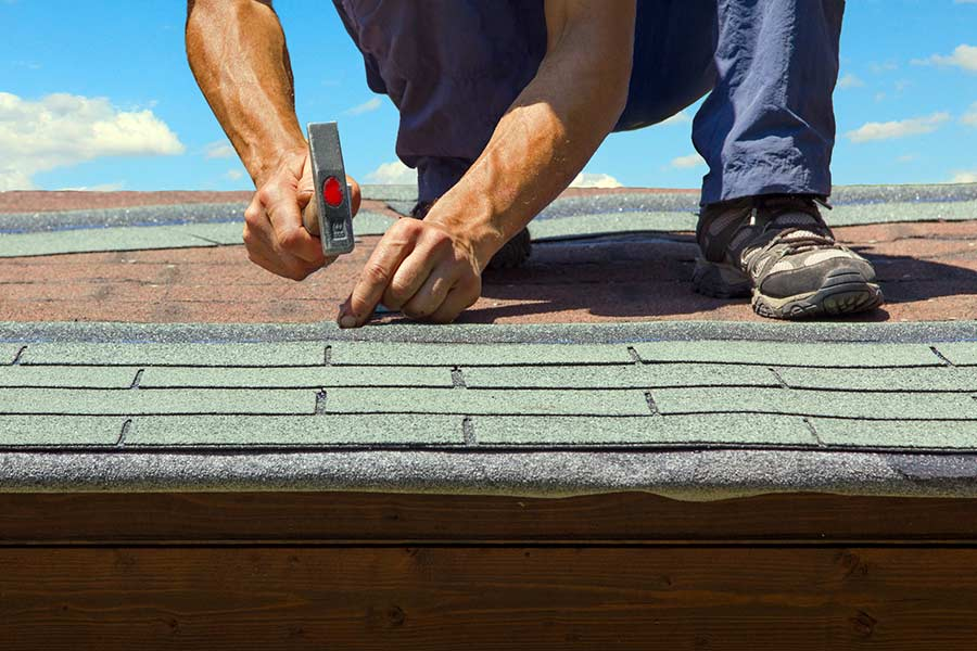 Asphalt shingle roof installation in progress