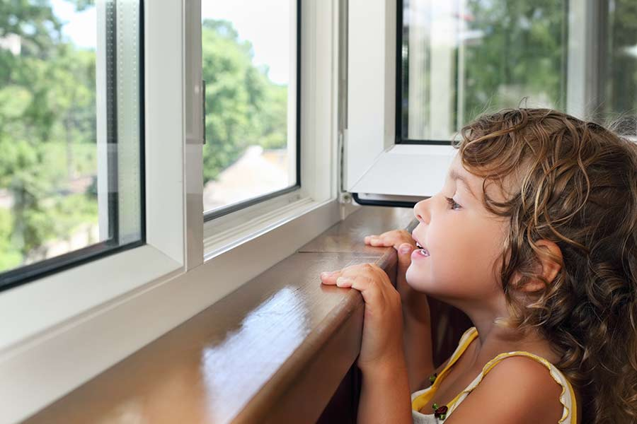 Girl looking out a window