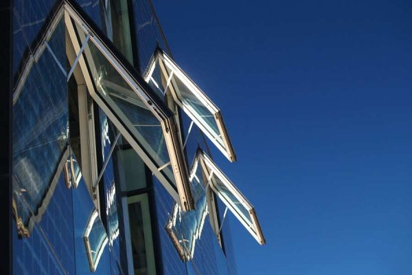 Open awning windows on a building facade
